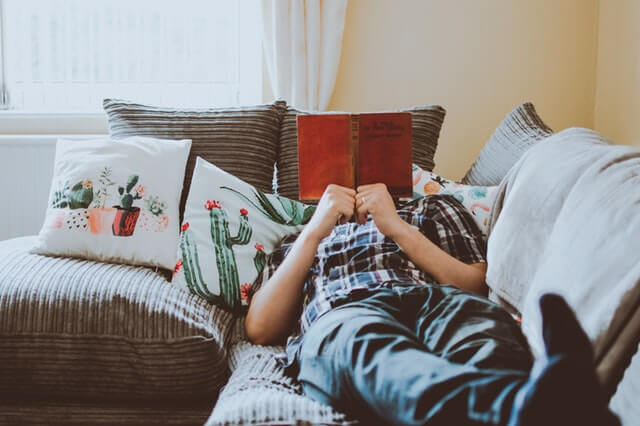 man relaxing on a cozy sofa